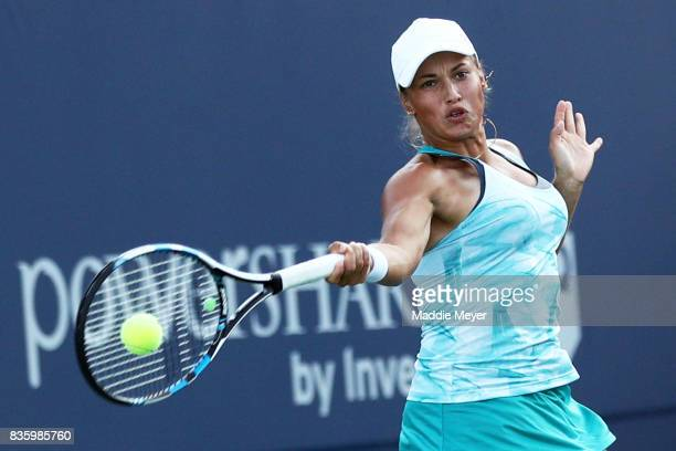 Yulia Putintseva of Kazakhstan returns a shot to Alize Cornet of France of during Day 3 of the Connecticut Open at Connecticut Tennis Center at Yale...