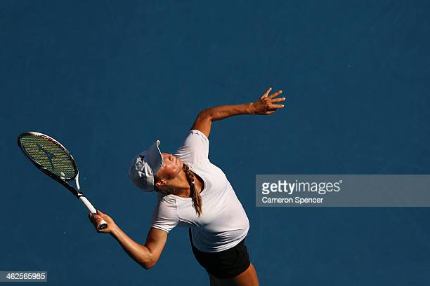 Yulia Putintseva of Kazakhstan serves in her first round match against Agnieszka Radwanska of Poland during day two of the 2014 Australian Open at...