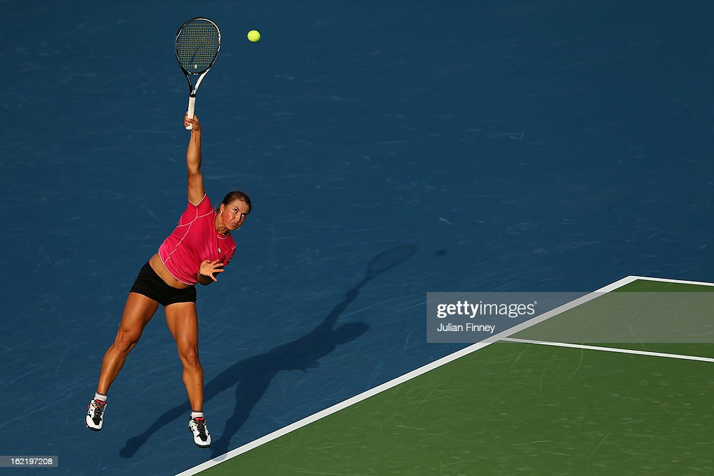 <a gi-track='captionPersonalityLinkClicked' href=/galleries/search?phrase=Yulia+Putintseva&family=editorial&specificpeople=6707401 ng-click='$event.stopPropagation()'>Yulia Putintseva</a> of Kazakhstan serves to Agnieszka Radwanska of Poland during day three of the WTA Dubai Duty Free Tennis Championship on February 20, 2013 in Dubai, United Arab Emirates.