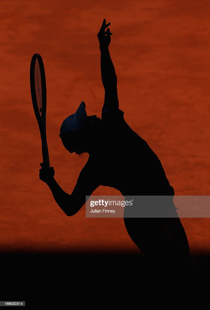 <a gi-track='captionPersonalityLinkClicked' href=/galleries/search?phrase=Yulia+Putintseva&family=editorial&specificpeople=6707401 ng-click='$event.stopPropagation()'>Yulia Putintseva</a> of Kazakhstan serves to Aravane Rezai of France during the Mutua Madrid Open tennis tournament at the Caja Magica on May 4, 2013 in Madrid, Spain.