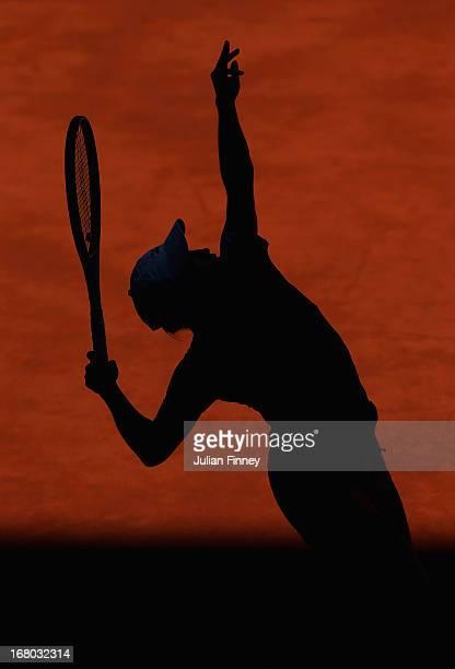 Yulia Putintseva of Kazakhstan serves to Aravane Rezai of France during the Mutua Madrid Open tennis tournament at the Caja Magica on May 4 2013 in...