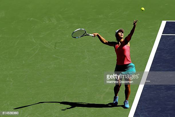 Yulia Putintseva of Kazakhstan serves to Shuai Peng of China during the BNP Paribas Open at the Indian Wells Tennis Garden on March 9 2016 in Indian...