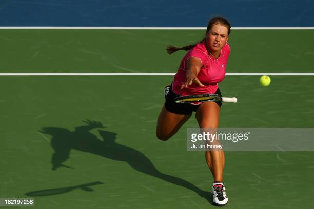 Yulia Putintseva of Kazakhstan throws her racket in an attempt to return the ball against Agnieszka Radwanska of Poland during day three of the WTA...
