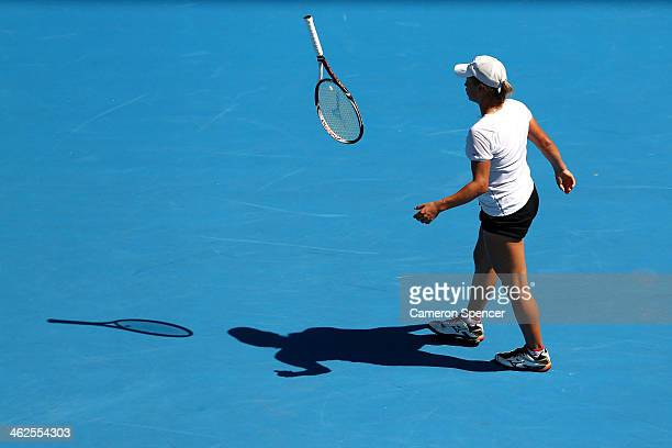 Yulia Putintseva of Kazakhstan throws her racquet in her first round match against Agnieszka Radwanska of Poland during day two of the 2014...