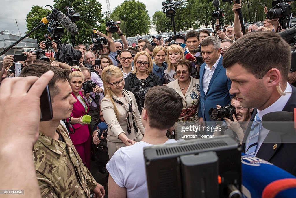 Yulia Tymoshenko, a member of parliament and leader of the Fatherland Party greets Ukrainian military pilot <a gi-track='captionPersonalityLinkClicked' href=/galleries/search?phrase=Nadiya+Savchenko&family=editorial&specificpeople=13678531 ng-click='$event.stopPropagation()'>Nadiya Savchenko</a> upon her arrival at Kyiv Boryspil Airport on May 25, 2016 in Boryspil, Ukraine. Savchenko was captured while fighting Russia-backed rebels in eastern Ukraine and put on trial in Russia on charges that she was complicit in the deaths of two Russian journalists. She was elected to parliament as a member of the Fatherland Party while being held in Russia, and in March she was convicted and sentenced to 22 years in prison, but was reportedly swapped for two Russian fighters captured by Ukrainian forces.