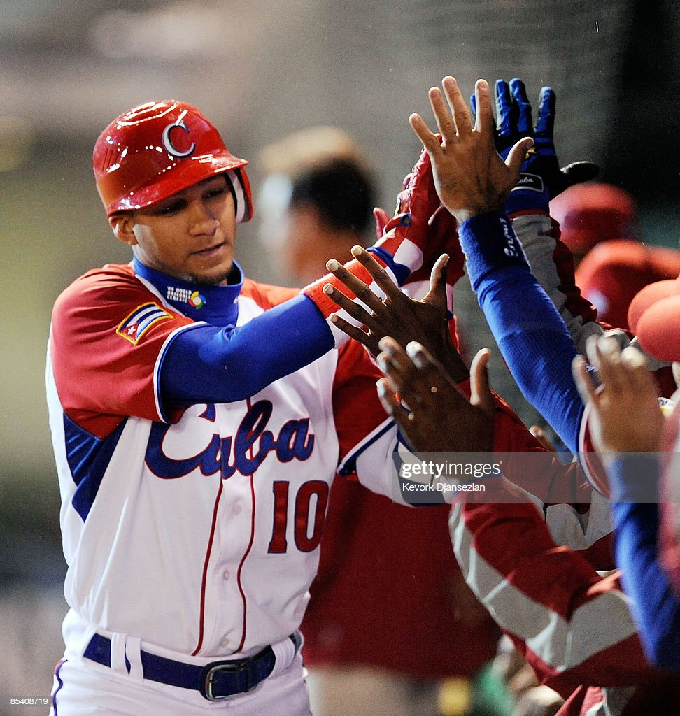 Yulieski Gourriel #10 of Cuba celebrates his two-run home run against Mexico with his teammates during the 2009 World Baseball Classic Pool B match on March 12, 2009 at the Estadio Foro Sol in Mexico City, Mexico.