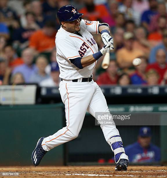 Yulieski Gurriel of the Houston Astros singles in a run in the sixth inning against the Texas Rangers at Minute Maid Park on September 14 2016 in...