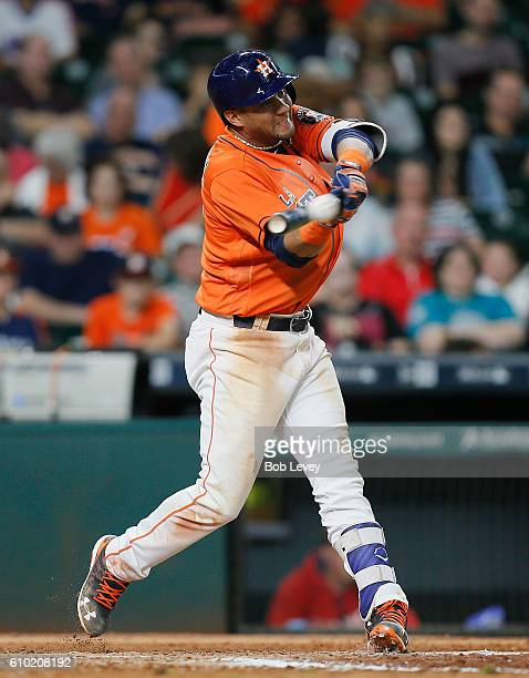 Yulieski Gurriel of the Houston Astros singles in the seventh inning scoring George Springer from third base against the Los Angeles Angels of...