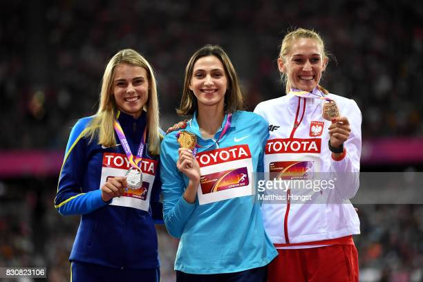 Yuliia Levchenko of Ukraine silver Maria Lasitskene of the Authorised Neutral Athletes gold and Kamila Licwinko of Poland pose with their medals for...