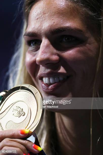 Yuliya Efimova of Russia poses with her gold medal after she wins the Women's 200m Breaststroke final during day fiifteen of the FINA World...