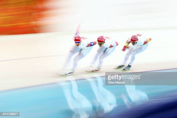 Yuliya Skokova Olga Graf and Yekaterina Shikhova of Russia compete during the Women's Team Pursuit Semifinals Speed Skating event on day fifteen of...