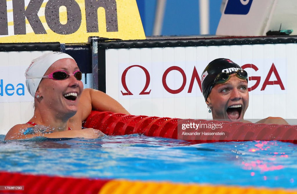 Yuliya Yefimova (R) of Russia celebrates her new world record with Jessica Hardy of the USA after the Swimming Women's 50m Breaststroke preliminaries heat eight on day fifteen of the 15th FINA World Championships at Palau Sant Jordi on August 3, 2013 in Barcelona, Spain.