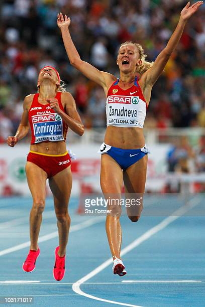 Yuliya Zarudneva of Russia wins the gold medal and Marta Dominguez of Spain wins the silver medal in the Womens 3000m Steeplechase Final during day...