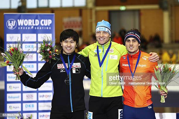 Yuma Murakami of Japan with the second place Nico Ihle of Germany with the first place and Jan Smeekens of Netherlands with the third place celebrate...