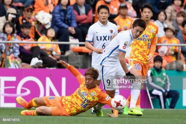 Yuma Suzuki of Kashima Antlers and Gakuto Notsuda of Shimizu SPulse compete for the ball during the JLeague J1 match between Shimizu SPulse and...
