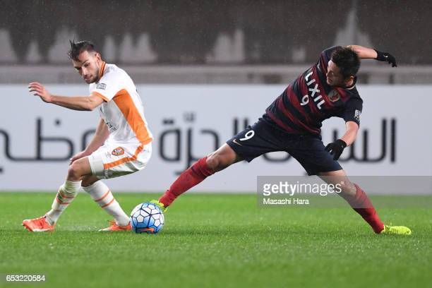 Yuma Suzuki of Kashima Antlers and Jack Hingert of Brisbane Roar compete for the ball during the AFC Champions League Group E match between Kashima...