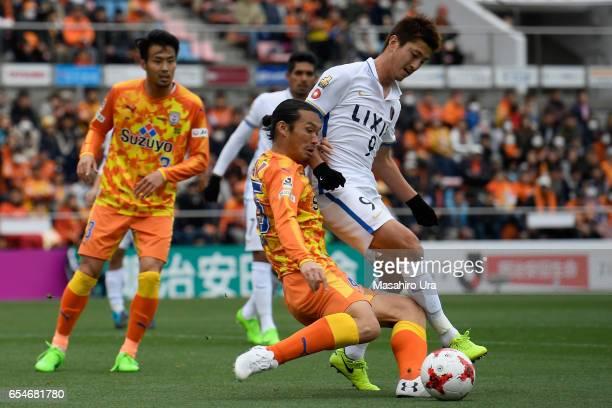 Yuma Suzuki of Kashima Antlers and Makoto Kakuda of Shimizu SPulse compete for the ball during the JLeague J1 match between Shimizu SPulse and...