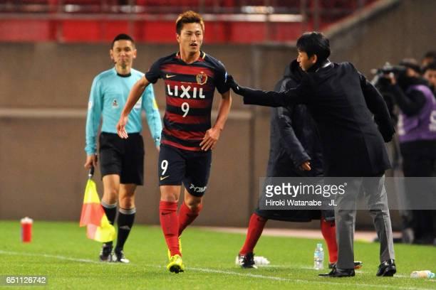 Yuma Suzuki of Kashima Antlers celebrates scoring the opening goal with manager Masatada Ishii during the JLeague J1 match between Kashima Antlers...