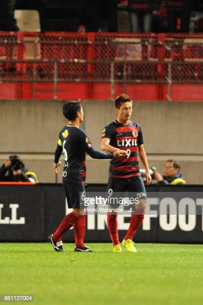 Yuma Suzuki of Kashima Antlers celebrates scoring the opening goal with his team mate Ryota Nagaki during the JLeague J1 match between Kashima...