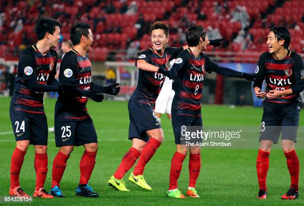 Yuma Suzuki of Kashima Antlers celebrates scoring the opening goal with his team mates during the AFC Champions League Group E match between Kashima...