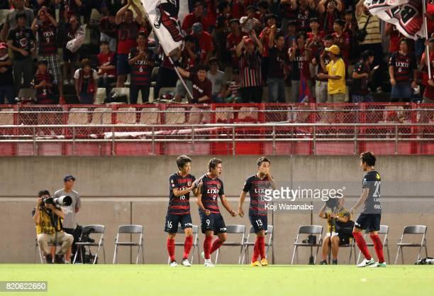 Yuma Suzuki of Kashima Antlers celebrates scoring the opening goal with his team mates during the preseason friendly match between Kashima Antlers...
