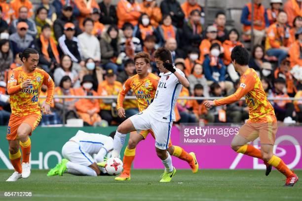 Yuma Suzuki of Kashima Antlers controls the ball under pressure of Shimizu SPulse defense during the JLeague J1 match between Shimizu SPulse and...
