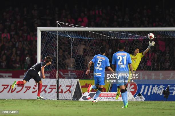 Yuma Suzuki of Kashima Antlers heads the ball to score his sides first goal past Jung Sung Ryong of Kawasaki Frontale during the JLeague J1 match...