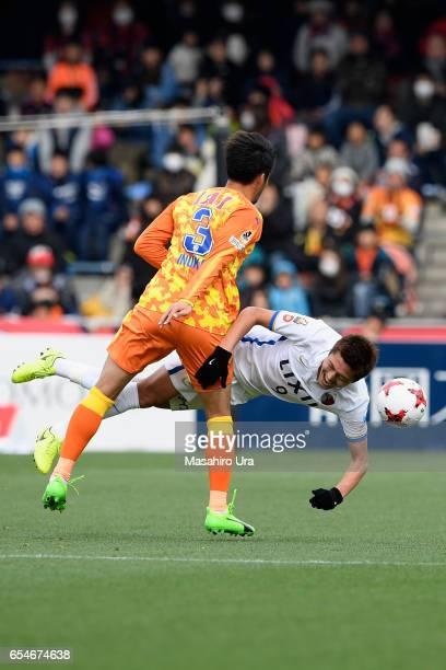 Yuma Suzuki of Kashima Antlers is challenged by Tomoya Inukai of Shimizu SPulse during the JLeague J1 match between Shimizu SPulse and Kashima...