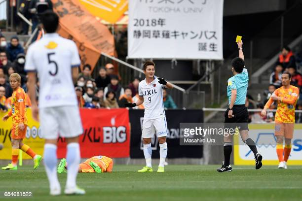 Yuma Suzuki of Kashima Antlers is shown a yellow card by referee Masuya Ueda during the JLeague J1 match between Shimizu SPulse and Kashima Antlers...