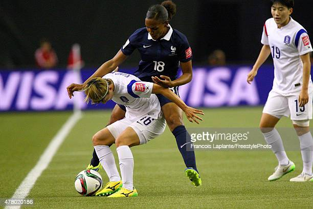 Yumi Kang of Korea controls the ball against MarieLaure Delie of France during the FIFA Women's World Cup Canada 2015 round of 16 match between...