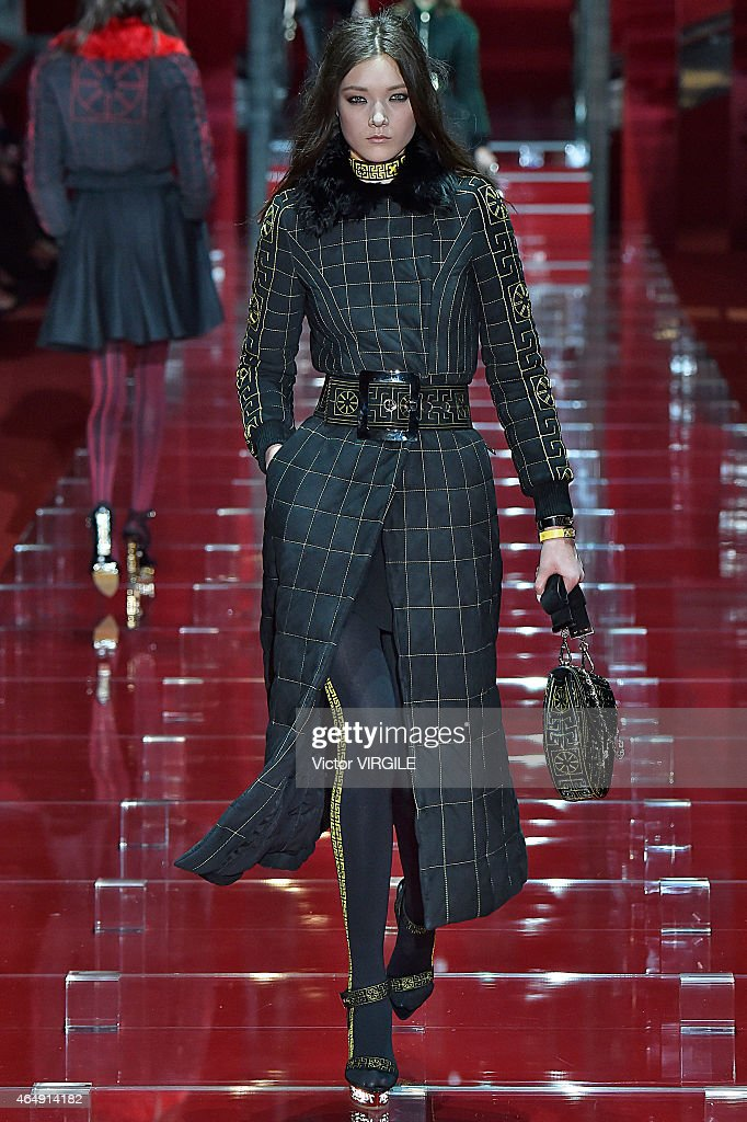 <a gi-track='captionPersonalityLinkClicked' href=/galleries/search?phrase=Yumi+Lambert&family=editorial&specificpeople=10529076 ng-click='$event.stopPropagation()'>Yumi Lambert</a> walks the runway at the Versace show during the Milan Fashion Week Autumn/Winter 2015 on February 27, 2015 in Milan, Italy.