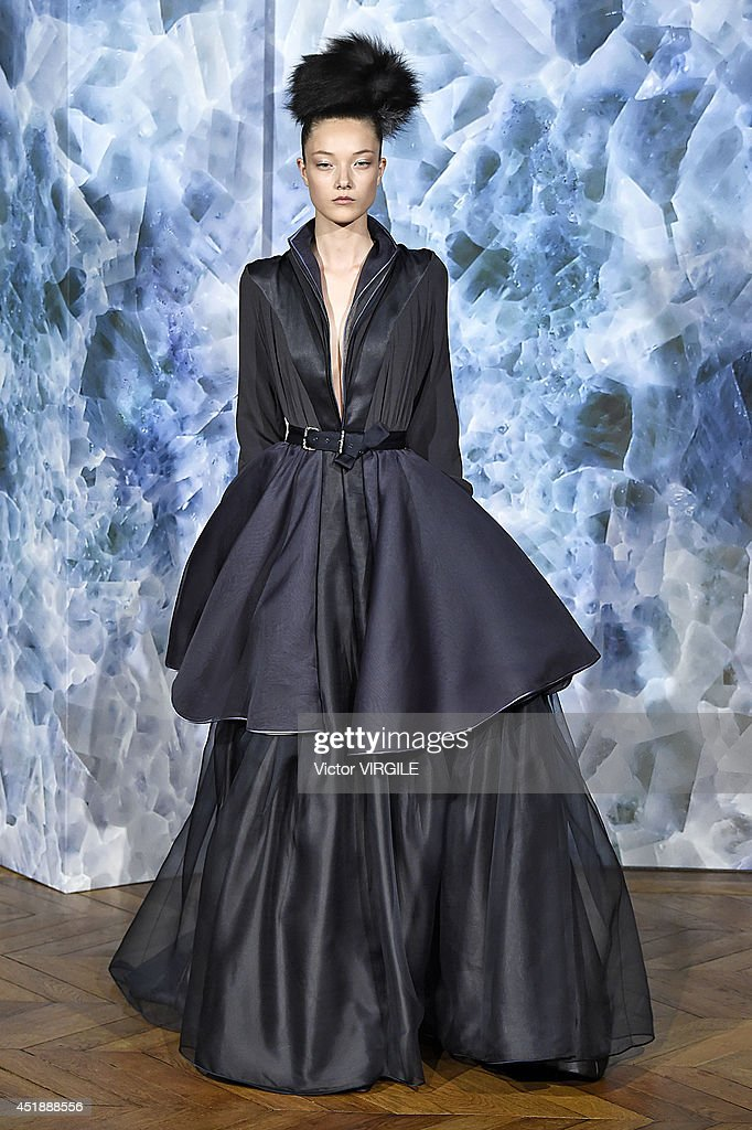 <a gi-track='captionPersonalityLinkClicked' href=/galleries/search?phrase=Yumi+Lambert&family=editorial&specificpeople=10529076 ng-click='$event.stopPropagation()'>Yumi Lambert</a> walks the runway during the Alexis Mabille show as part of Paris Fashion Week - Haute Couture Fall/Winter 2014-2015 at on July 7, 2014 in Paris, France.
