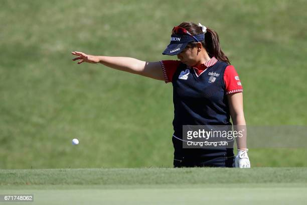 Yumiko Yoshida of Japan drops a ball on the 16th hole during the final round of Fujisankei Ladies Classic at the Kawana Hotel Golf Course Fuji Course...