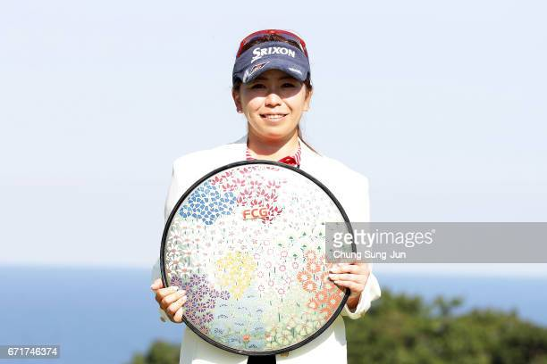 Yumiko Yoshida of Japan lifts the Championship's trophy during a ceremony following the Fujisankei Ladies Classic at the Kawana Hotel Golf Course...
