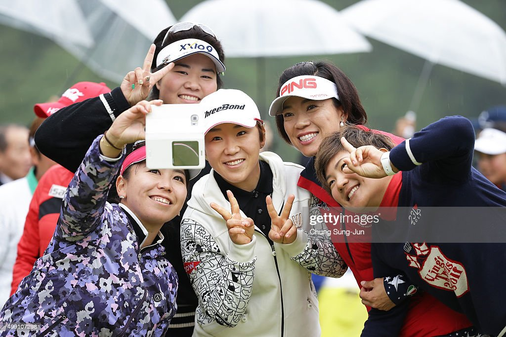 <a gi-track='captionPersonalityLinkClicked' href=/galleries/search?phrase=Yumiko+Yoshida&family=editorial&specificpeople=9011187 ng-click='$event.stopPropagation()'>Yumiko Yoshida</a> of Japan takes a selfie with <a gi-track='captionPersonalityLinkClicked' href=/galleries/search?phrase=Shiho+Oyama&family=editorial&specificpeople=4166619 ng-click='$event.stopPropagation()'>Shiho Oyama</a>, <a gi-track='captionPersonalityLinkClicked' href=/galleries/search?phrase=Misuzu+Narita&family=editorial&specificpeople=9567982 ng-click='$event.stopPropagation()'>Misuzu Narita</a>, <a gi-track='captionPersonalityLinkClicked' href=/galleries/search?phrase=Miki+Sakai+-+Golfspelare&family=editorial&specificpeople=14589325 ng-click='$event.stopPropagation()'>Miki Sakai</a> of Japan and Ji-Yai Shin of South Korea after the LPGA Tour Championship Ricoh Cup 2015 at the Miyazaki Country Club on November 29, 2015 in Miyazaki, Japan.