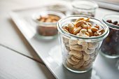 Shot of bowls of various nuts on a table
