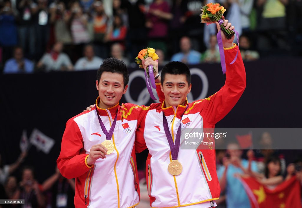 Yun Cai and <a gi-track='captionPersonalityLinkClicked' href=/galleries/search?phrase=Haifeng+Fu&family=editorial&specificpeople=647789 ng-click='$event.stopPropagation()'>Haifeng Fu</a> (R) of China celebrate on the podium with their Gold Medals following their victory against Mathias Boe and Carsten Mogensen of Denmark in their Men's Doubles Badminton Gold Medal match on Day 9 of the London 2012 Olympic Games at Wembley Arena on August 5, 2012 in London, England.