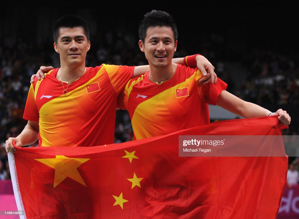 Yun Cai and <a gi-track='captionPersonalityLinkClicked' href=/galleries/search?phrase=Haifeng+Fu&family=editorial&specificpeople=647789 ng-click='$event.stopPropagation()'>Haifeng Fu</a> (L) of China celebrate victory against Mathias Boe and Carsten Mogensen of Denmark in their Men's Doubles Badminton Gold Medal match on Day 9 of the London 2012 Olympic Games at Wembley Arena on August 5, 2012 in London, England.
