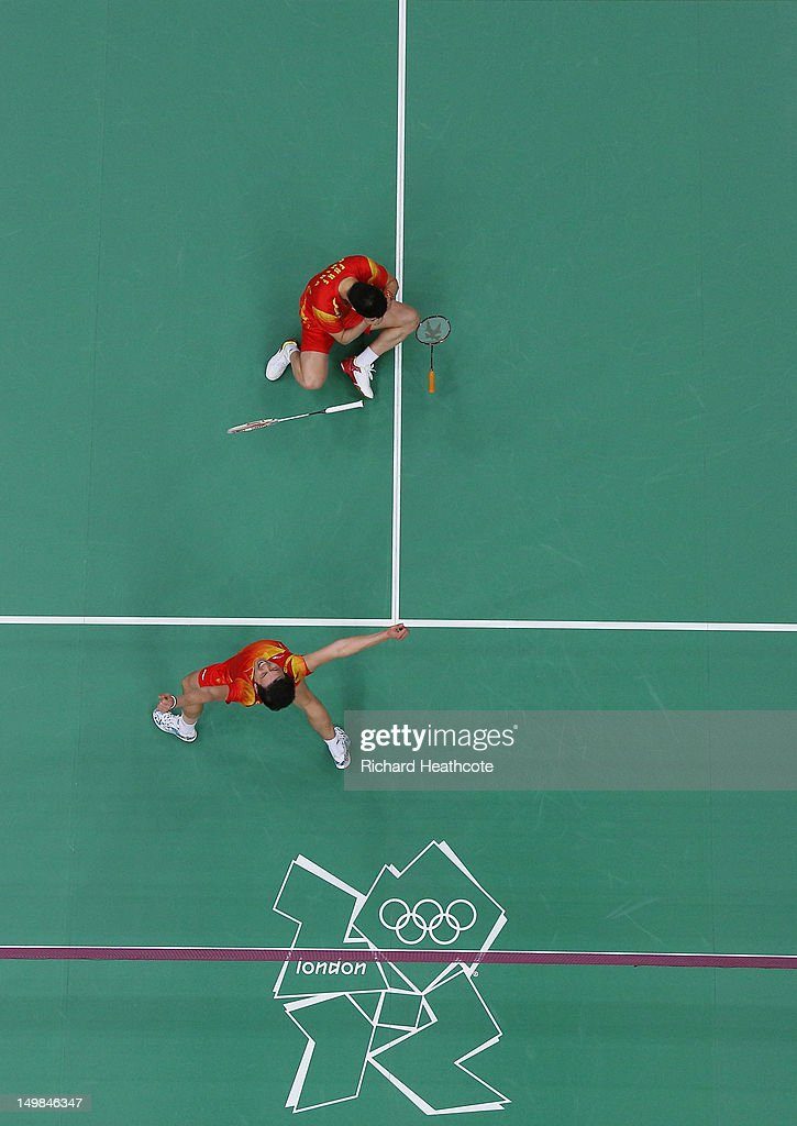 Yun Cai and <a gi-track='captionPersonalityLinkClicked' href=/galleries/search?phrase=Haifeng+Fu&family=editorial&specificpeople=647789 ng-click='$event.stopPropagation()'>Haifeng Fu</a> (R) of China celebrate victory against Mathias Boe and Carsten Mogensen of Denmark in their Men's Doubles Badminton Gold Medal match on Day 9 of the London 2012 Olympic Games at Wembley Arena on August 5, 2012 in London, England.