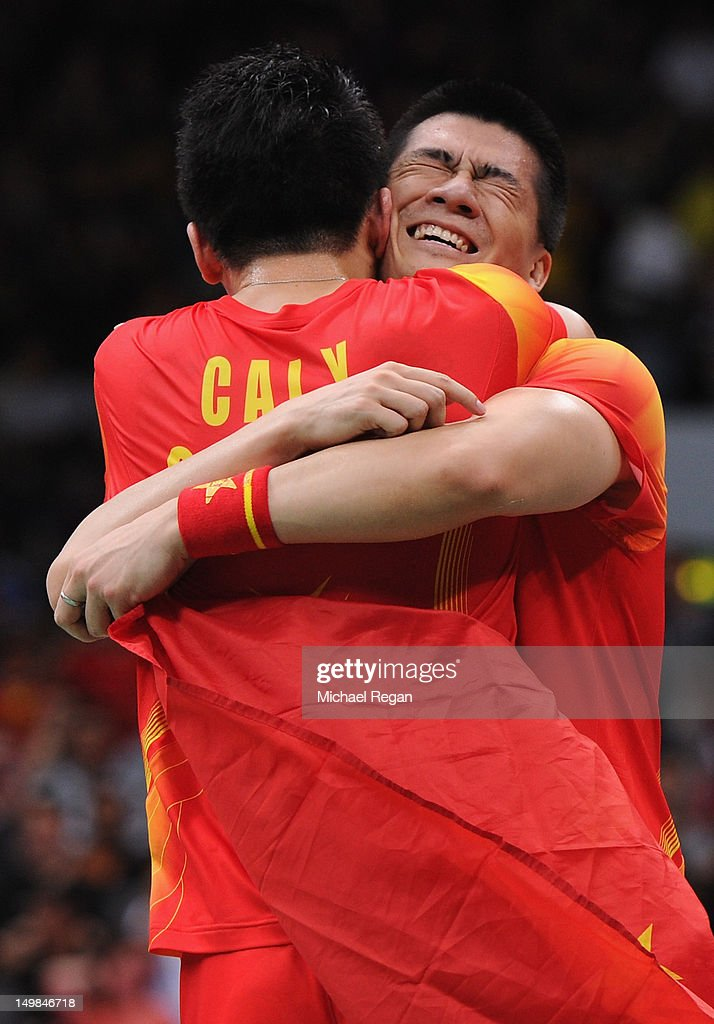 Yun Cai and Haifeng Fu (R) of China celebrate victory against Mathias Boe and Carsten Mogensen of Denmark in their Men's Doubles Badminton Gold Medal match on Day 9 of the London 2012 Olympic Games at Wembley Arena on August 5, 2012 in London, England.