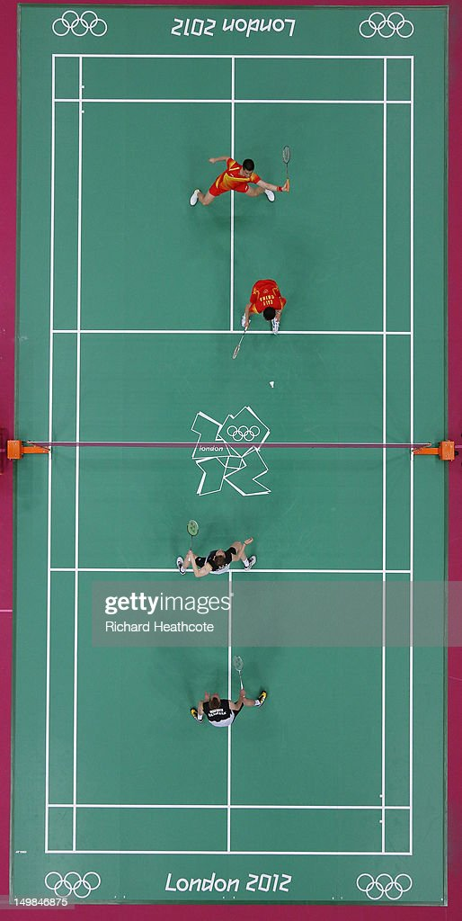 Yun Cai and Haifeng Fu of China compete against Mathias Boe and Carsten Mogensen of Denmark in their Men's Doubles Badminton Gold Medal match on Day 9 of the London 2012 Olympic Games at Wembley Arena on August 5, 2012 in London, England.