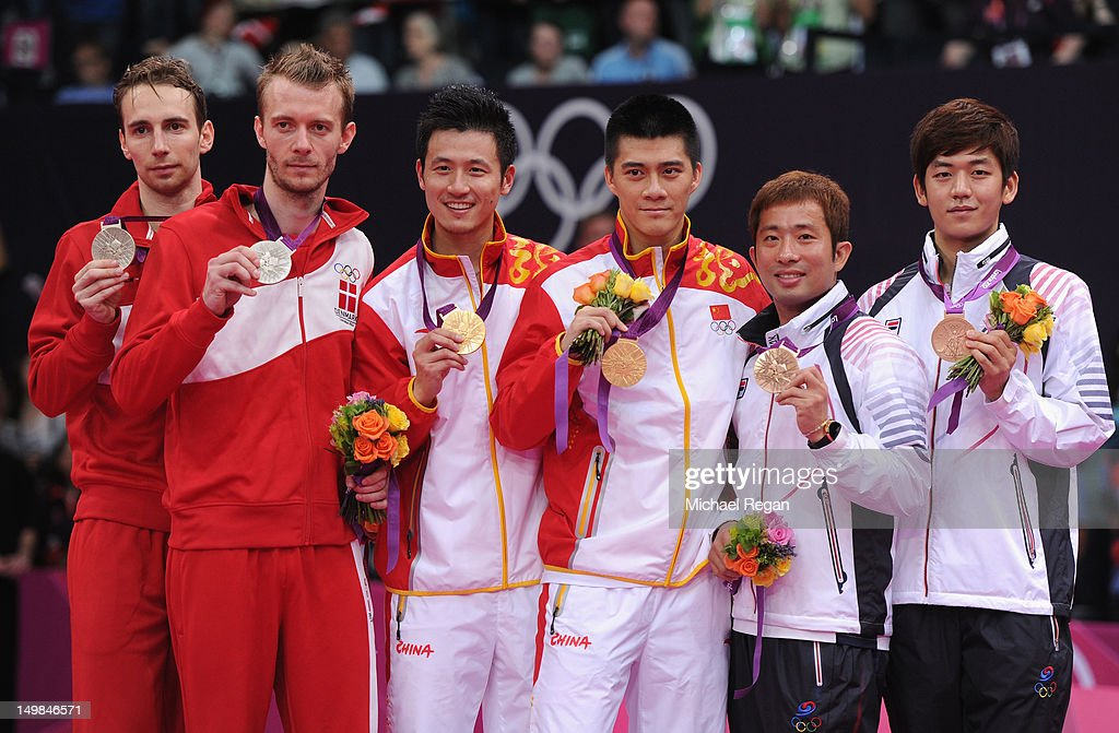 Yun Cai and Haifeng Fu of China stand on the podium with their Gold Medals, Mathias Boe and Carsten Mogensen of Denmark (L) their Silver and Yong Dae Lee and Jae Sung Chung of Korea (R) their Bronze following the Men's Doubles Badminton Gold Medal match on Day 9 of the London 2012 Olympic Games at Wembley Arena on August 5, 2012 in London, England.