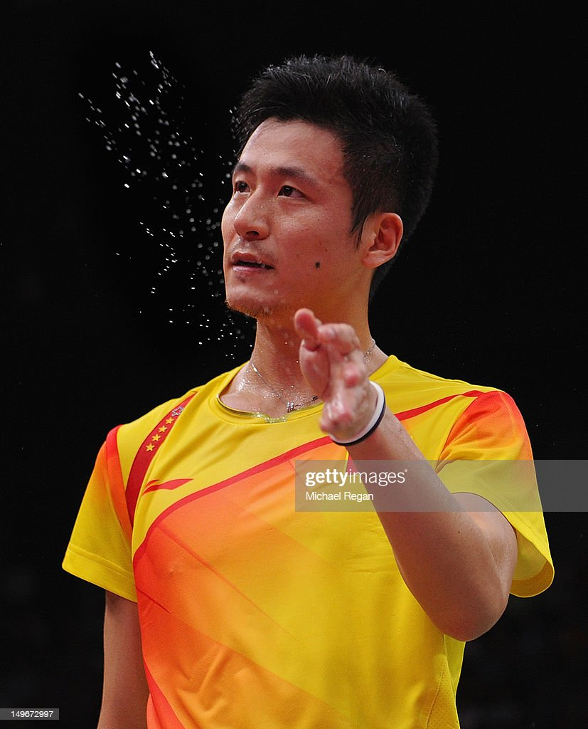 Yun Cai of China flicks away sweat against Biao Chai and Zendong Guo of China in their Men's Doubles Badminton quarter final on day 6 of the London 2012 Olympic Games at Wembley Arena on August 2, 2012 in London, England.