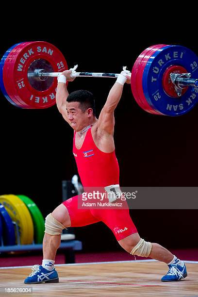 Yun Chol Om from North Korea lifts in the the Clean and Jerk men's 56 kg Group A competition during the during the the IWF Weightlifting World...