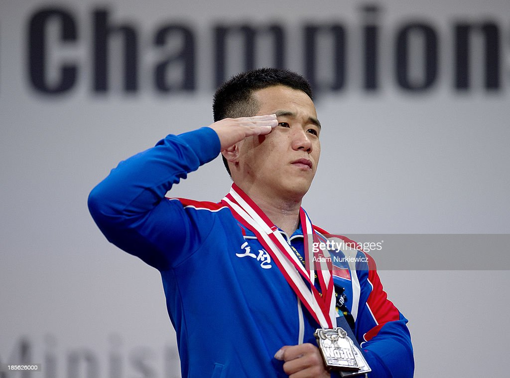 Yun Chol Om from North Korea with the gold medal during the the medal ceremony after the men's 56 kg Group A weightlifting IWF World Championships Wroclaw 2013 at Centennial Hall on October 21, 2013 in Wroclaw, Poland.