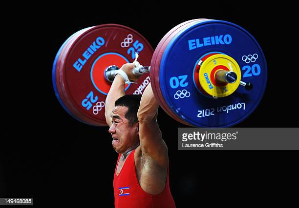 Yun Chol Om of DPR Korea breaks the Olympic Record in the Mens 56kg Group B clean and jerk weightlifting on Day 2 of the London 2012 Olympic Games at...
