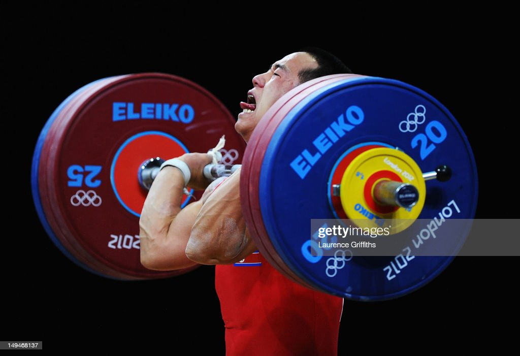 Yun Chol Om of DPR Korea breaks the Olympic Record in the Mens 56kg Group B clean and jerk weightlifting on Day 2 of the London 2012 Olympic Games at ExCeL on July 29, 2012 in London, England.