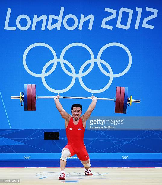 Yun Chol Om of DPR Korea celebrates breaking the Olympic Record in the Mens 56kg Group B weightlifting on Day 2 of the London 2012 Olympic Games at...