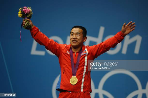 Yun Chol Om of DPR Korea celebrates with the gold medal on the podium after the Men's 56kg Weightlifting on Day 2 of the London 2012 Olympic Games at...