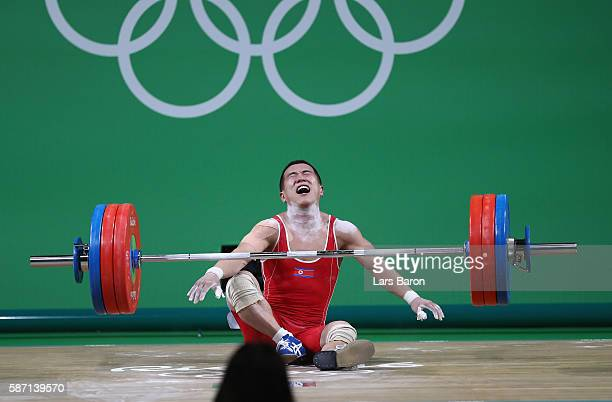 Yun Chol Om of North Korea reacts after failing to lift during the Men's 56kg Group A weightlifting contest on Day 2 of the Rio 2016 Olympic Games at...